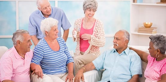 Group of seniors gathered to discuss their top options regarding senior living communities, using resources found at Senior Management Advisors's website