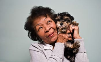 Another joyous Grand Villa of Delray East resident enjoying a moment with her puppy