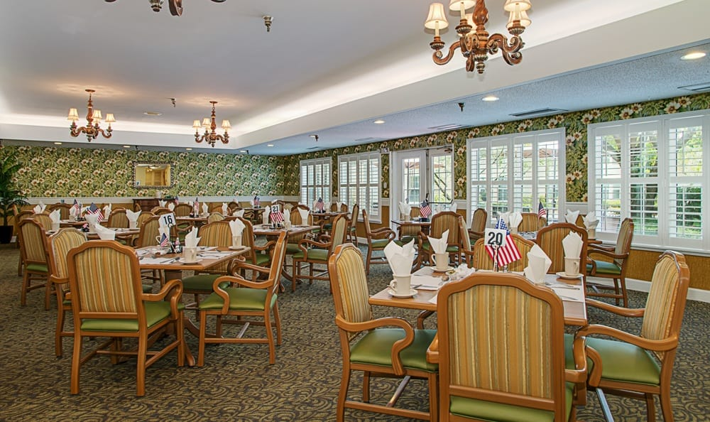 Dining hall with green accents at Grand Villa of Largo in Florida