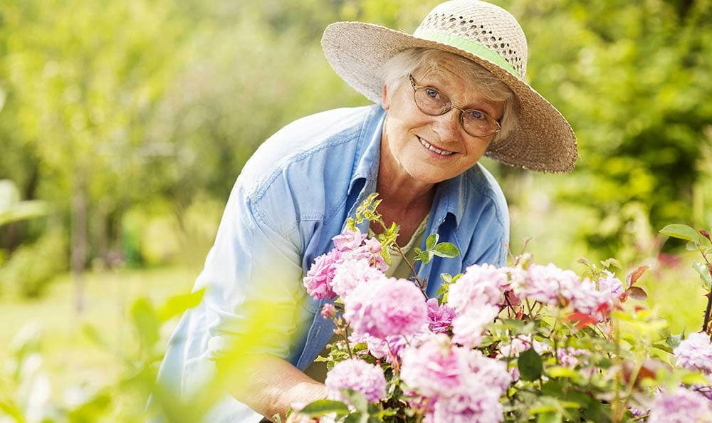Woman gardening at Grand Villa of New Port Richey