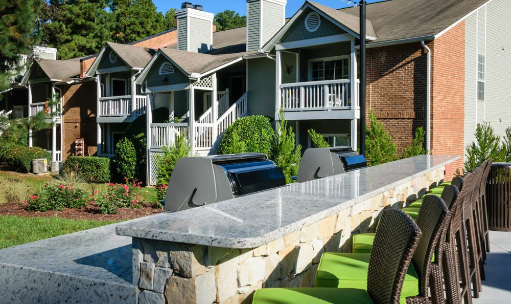 Entertain guests on the community patio at Cumberland Cove in Raleigh, NC
