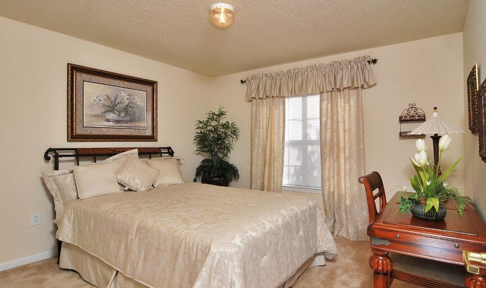 Master bedroom at Arbor Lake Apartments in Covington, GA.