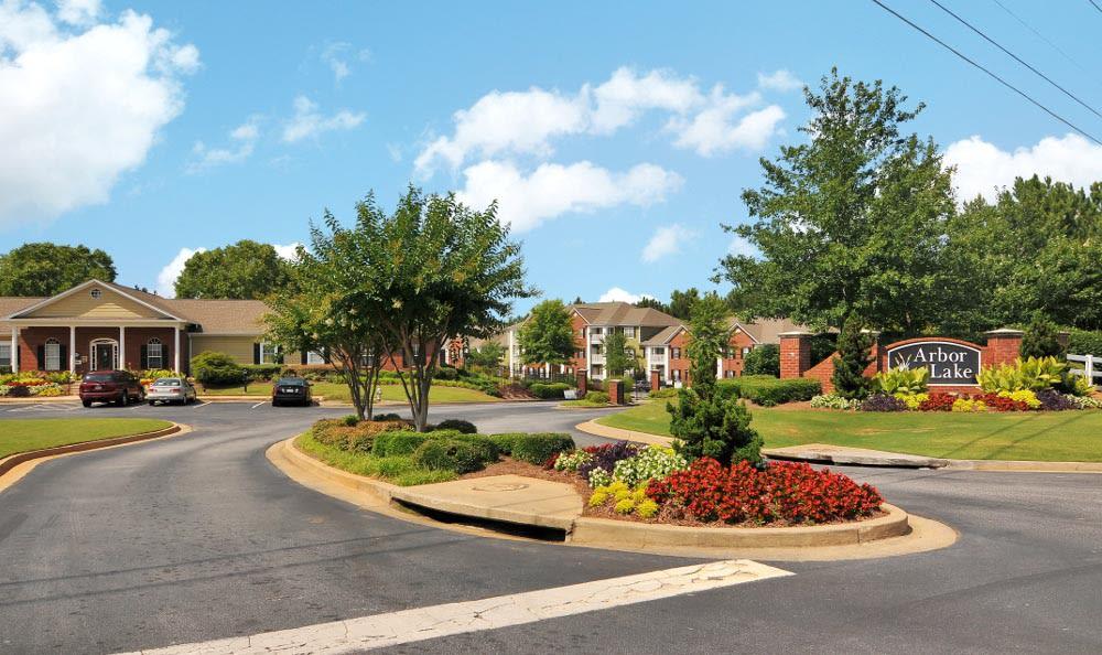 Beautiful entrance to Arbor Lake Apartments in Covington, GA.
