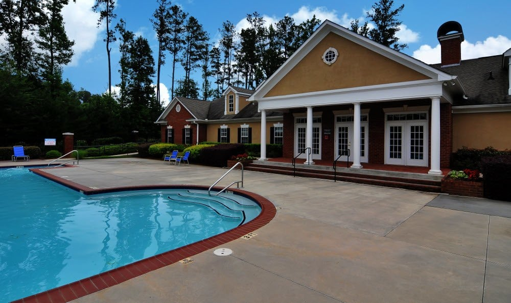 Exterior of clubhouse at Cobblestone Landing Apartments in Kennesaw, GA