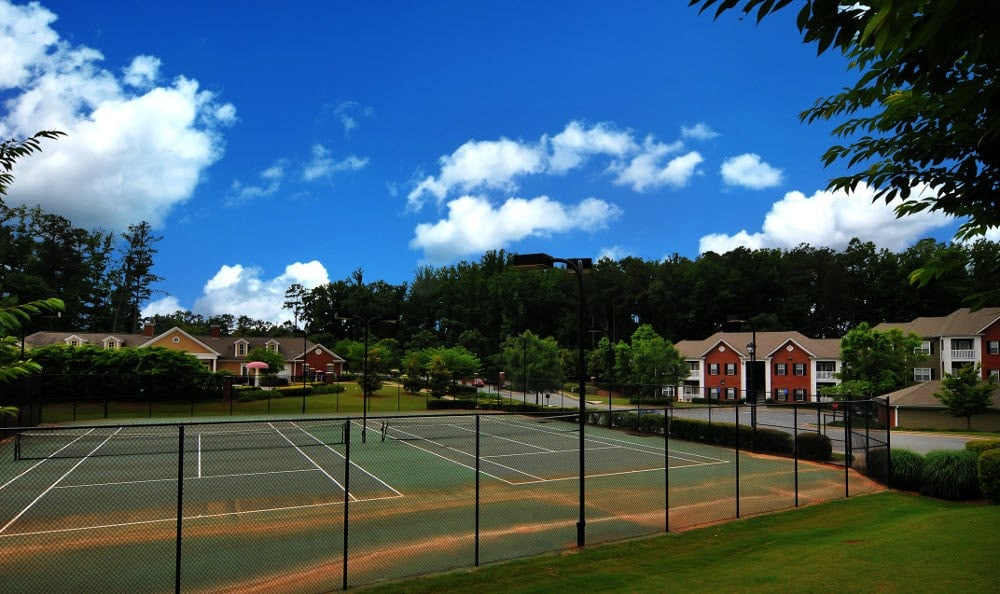 Tennis court at Cobblestone Landing Apartments in Kennesaw, GA