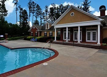 Relax by the pool at Cobblestone Landing Apartments