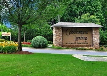 Enjoy the flowers at Cobblestone Landing Apartments