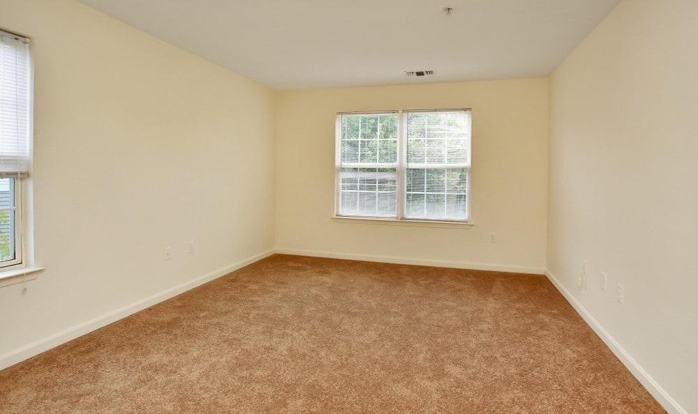 Bright master bedroom at England Run North Apartments in Fredericksburg, VA