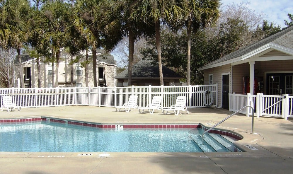 Relax in the sun by the pool at Savannah Sound Apartments in FL.