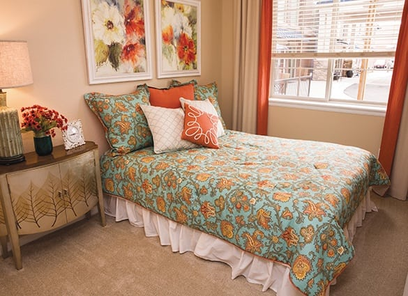 Well decorated bedroom with bed at Las Palomas Senior Living in Mesa, Arizona