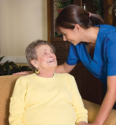 Caring staff member with resident at The Enclave at Round Rock Senior Living in Round Rock, Texas