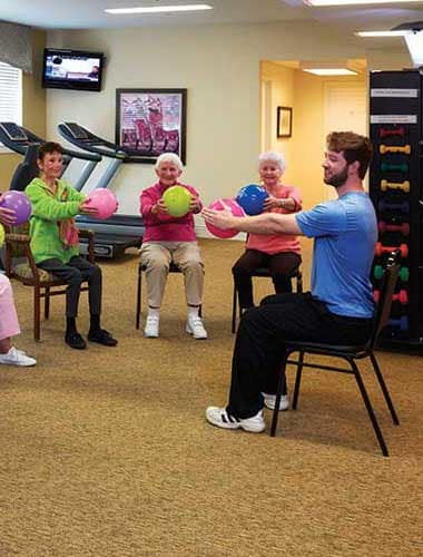 Ball exercise class at Park Meadows Senior Living in Kansas