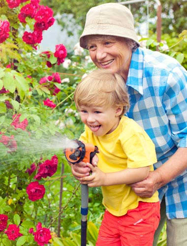 Grandson helping grandmother gardening at Park Meadows Senior Living