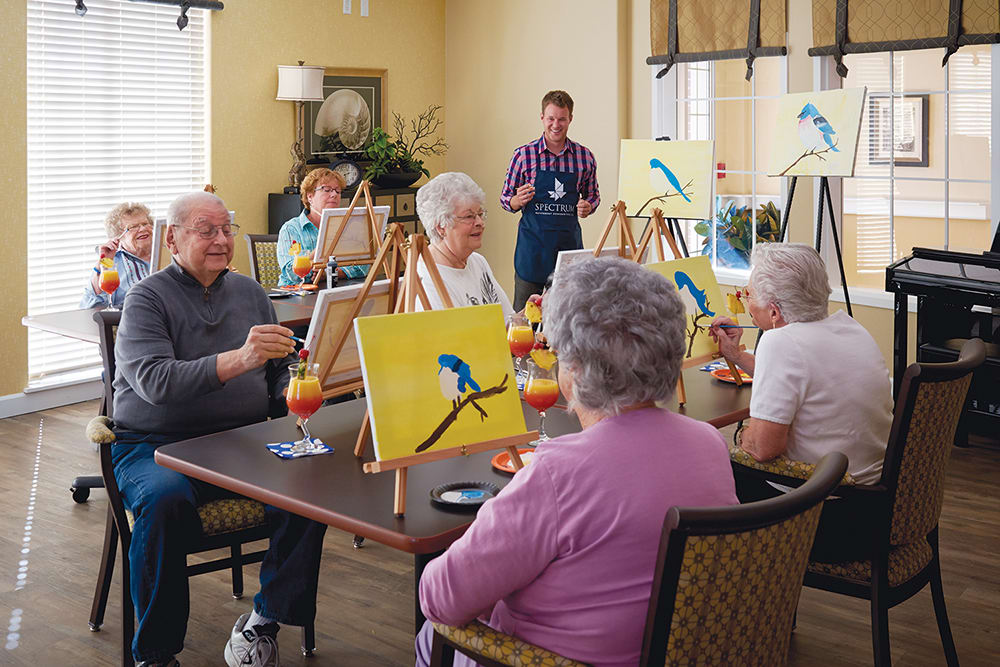 Residents painting masterpieces at Park Meadows Senior Living