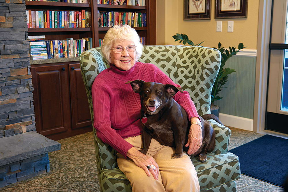 A resident and her pet doggy at Park Meadows Senior Living