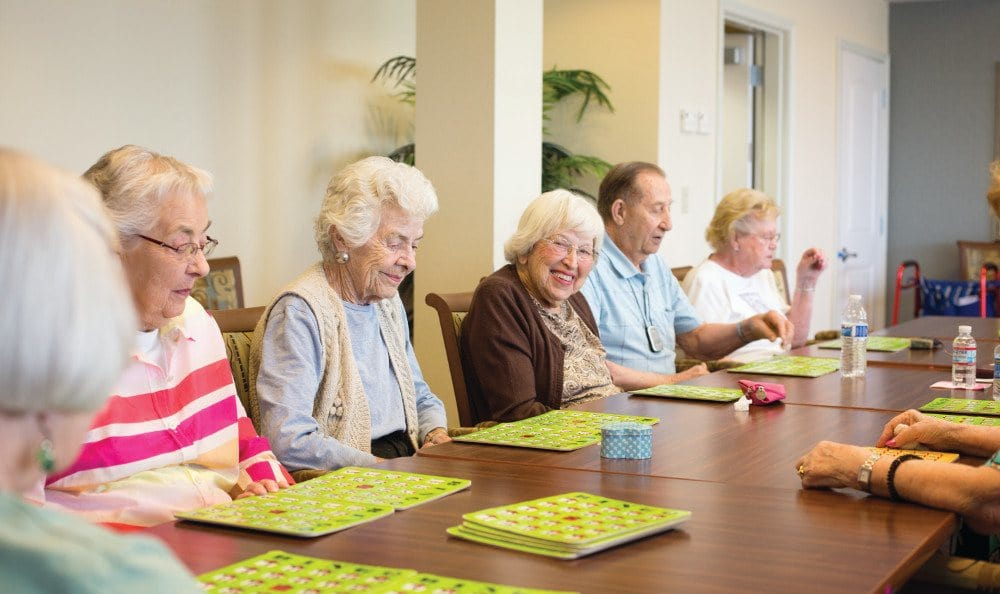 Friends playing bingo at our assisted living facility in Cary, IL