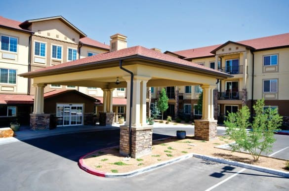 Exterior entrance of The Enclave at Round Rock Senior Living in Round Rock, Texas
