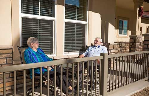 Senior couple enjoy the New Mexico sun on their patio.