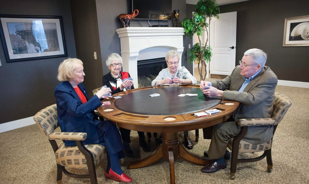 Friends playing cards here at Crescent Park Senior Living