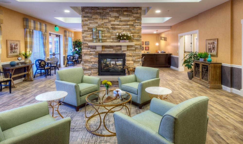 Fireplace lounging at our senior living facility in Creve Coeur, MO