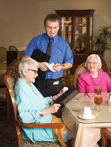Seniors ordering a lovely meal at Green Oaks Senior Living