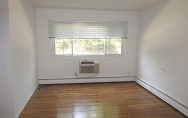 Air conditioner in the living room at Eagle Rock Apartments at Mineola