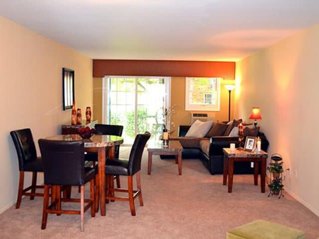 Dining and living room area at Eagle Rock Apartments at Woodbury.