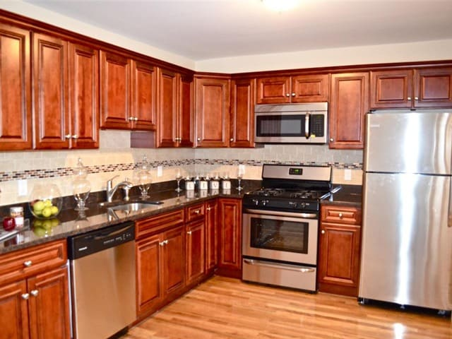 Kitchen with stainless steel appliances at Eagle Rock Apartments at Woodbury.