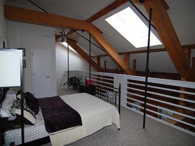 Loft bedroom at Beacon Mill Village.