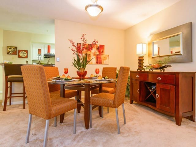 Dining room with a look into the kitchen at Brookview Apartments.