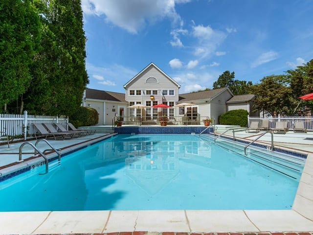 Pool with lounging areas at Brookview Apartments.