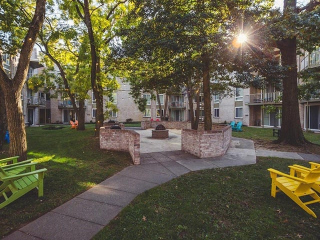 Fire pit community lounging at West River Apartments.