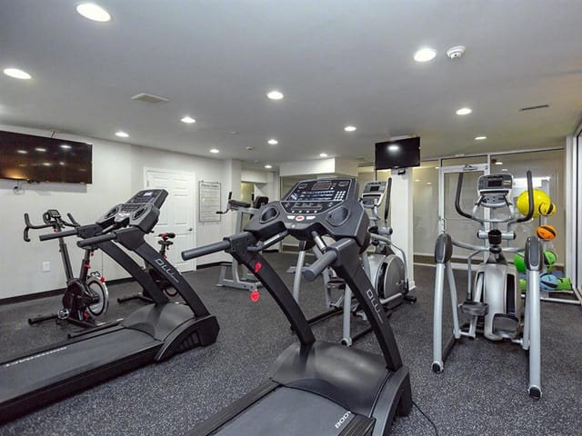 Fitness center at West River Apartments.