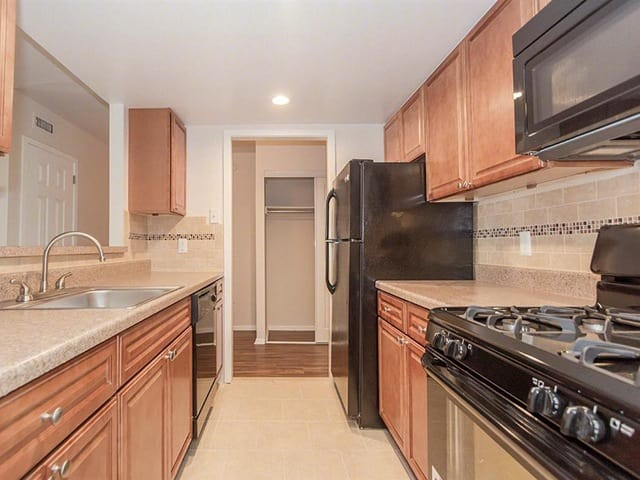 Galley style kitchen at West River Apartments.