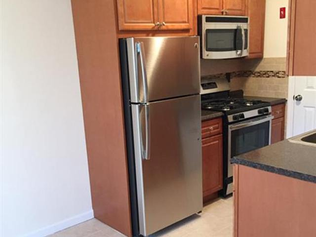 Kitchen with stainless steel appliances at Bunt Commons.