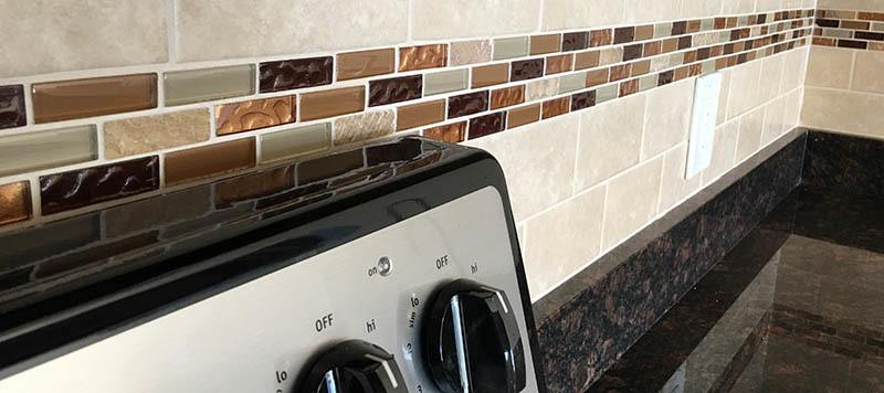 Tile backsplashes at our Coram apartments