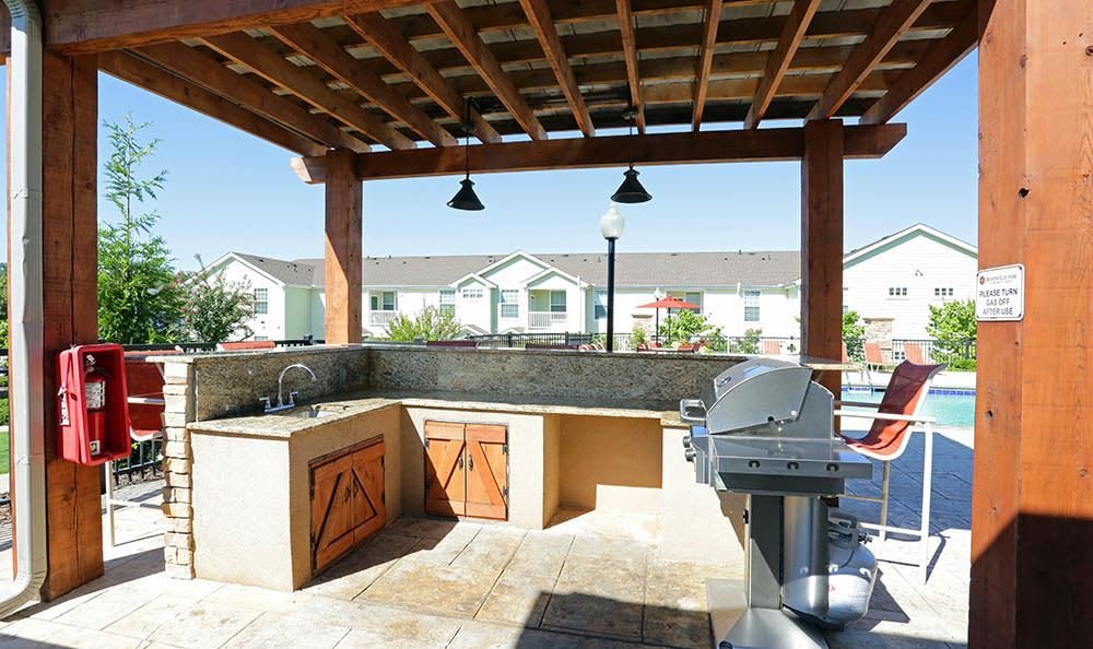 Invite friends over for BBQ at your new Huntsville apartment