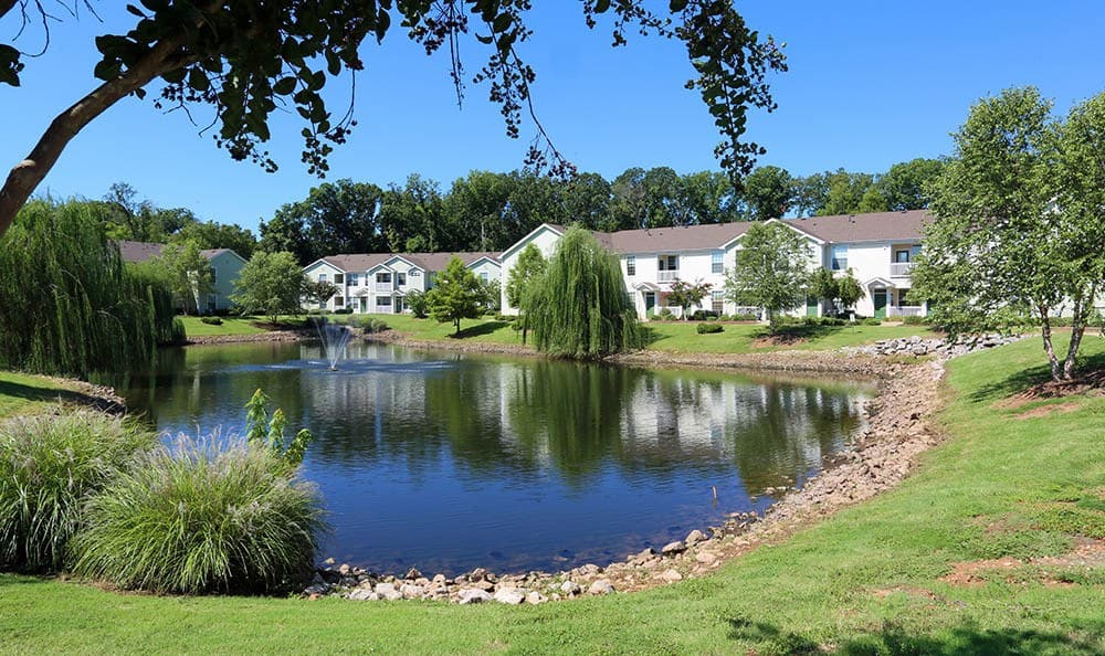 Relax by our Huntsville apartments pond