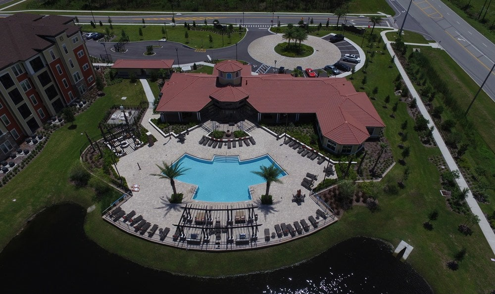 Aerial view of the pond and clubhouse at apartments in Daytona Beach