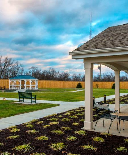 The community at Artis Senior Living of Chestnut Ridge features a neighborhood square common area for residents to relax