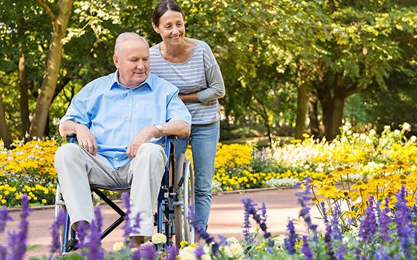 A senior living resident and caregiver at Great Falls Assisted Living