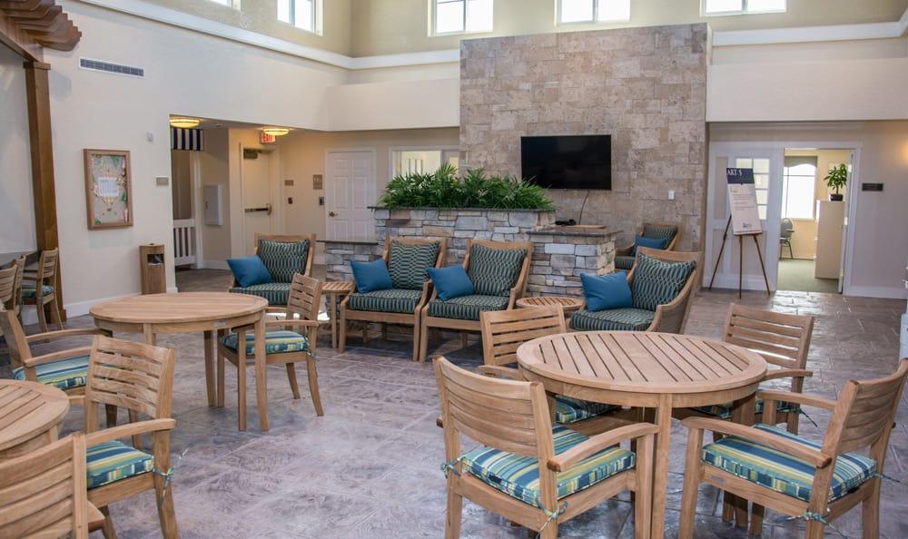 Common area with patio furniture at Artis Senior Living of Boca Raton in Boca Raton, Florida