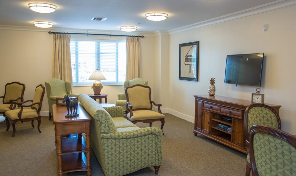 Entertainment room at senior living in {[location_city}}