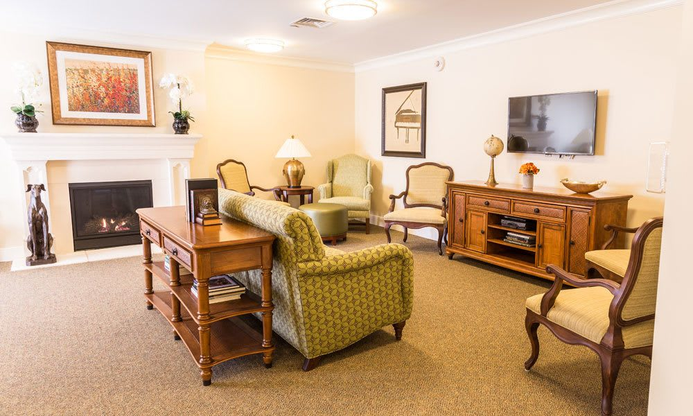 A room with fireplace and seating at Artis Senior Living of Evesham in Evesham, New Jersey