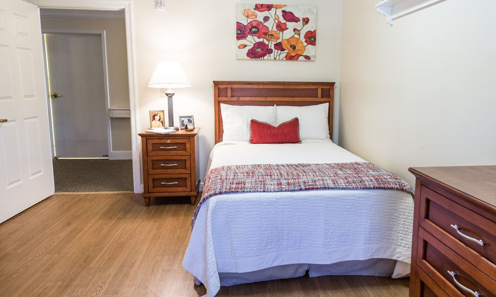 An apartment bedroom at Artis Senior Living of Evesham in Evesham, New Jersey