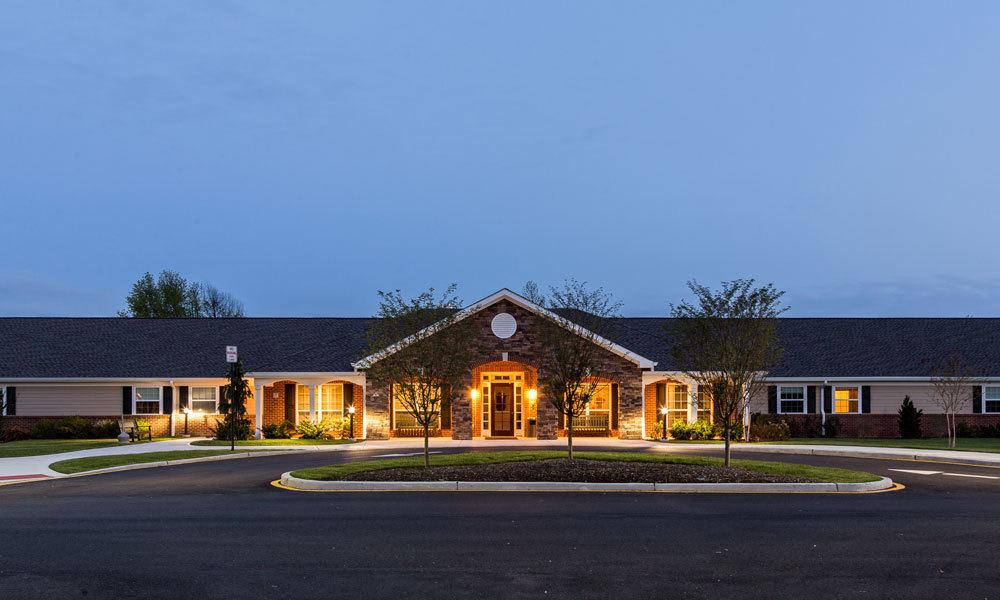 The front of the building at Artis Senior Living of Evesham in Evesham, New Jersey at night