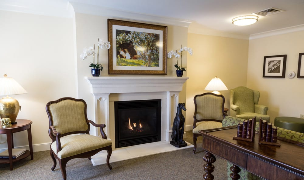 Lounge at senior living in Lower Moreland includes a fireplace