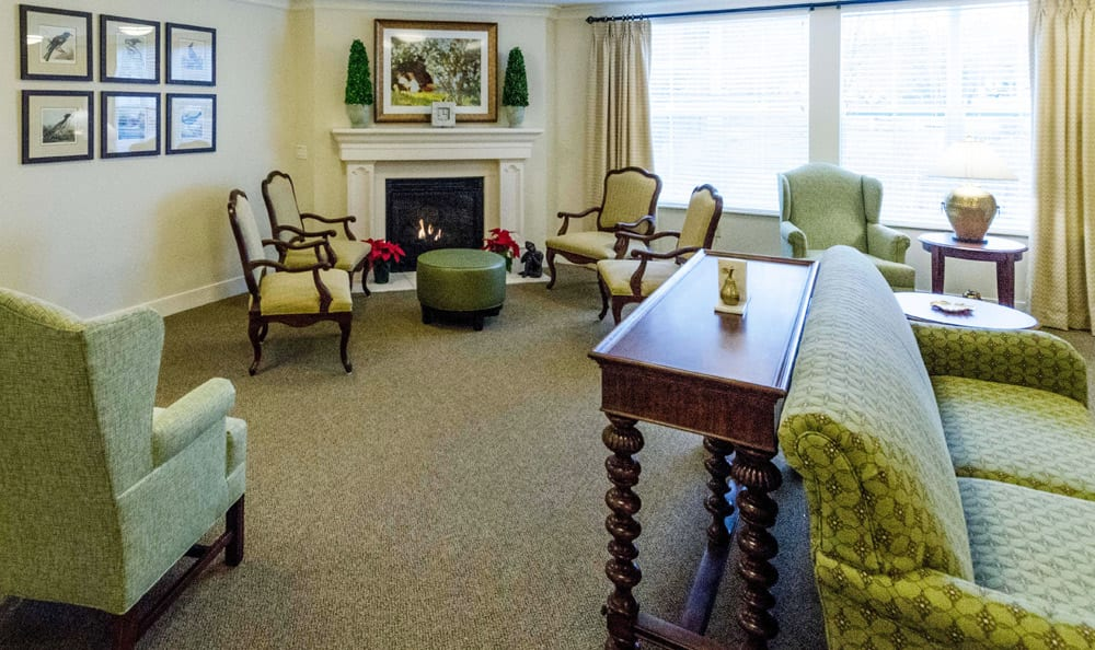 Lounge with fireplace at Artis Senior Living of Reading