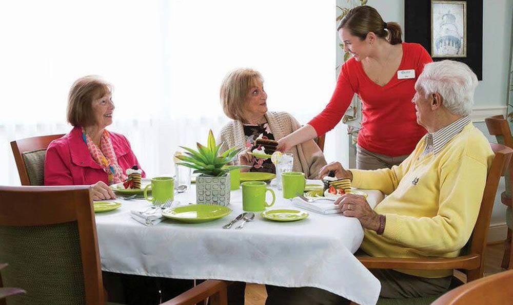tenants having dinner at Olney Memory Care
