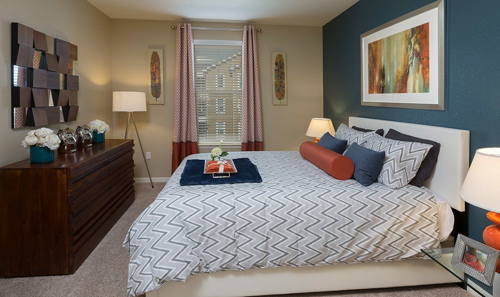 Interior master bedroom in luxury apartment home at Integra Cove